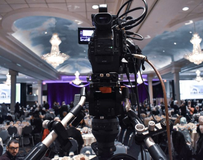 Canva – Professional video camera recording event in ballroom (1)